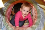 playing in her tunnel