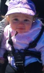 Loves rides in the stroller- laughs at Fi and Kota running around.