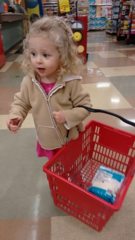Willa shops with me and hold the basket--- she won't let me help her, so by the end she is dragging the thing thru the store- it's so funny