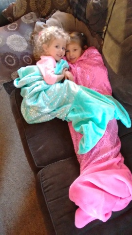 a couple of cute mermaids in their new blankets!